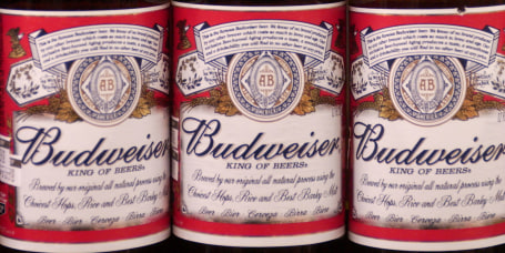 Bottles of Anheuser-Busch's Budweiser beer sit on display in
