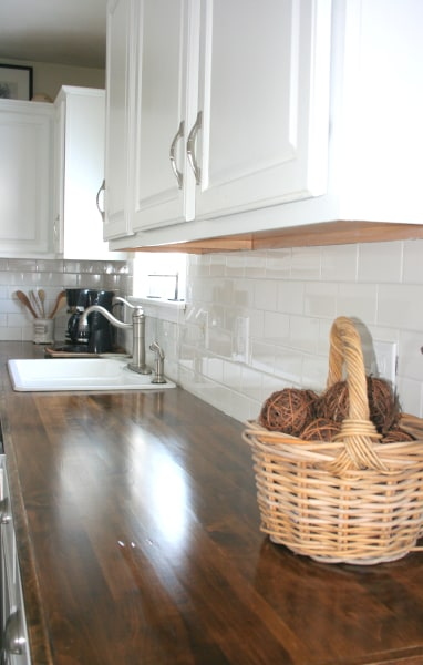 See what this kitchen looks like after an 800 diy for Cheap countertop ideas for kitchen