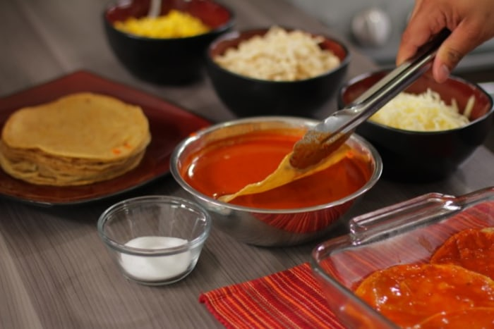 Dip tortillas in enchilada sauce for enchilada casserole