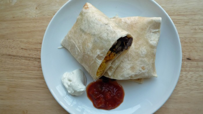 Freezer breakfast burrito (plated with salsa and sour cream)