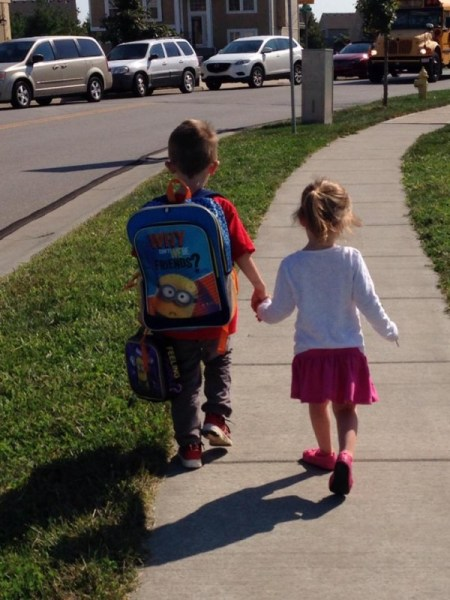 Small children walking off to school