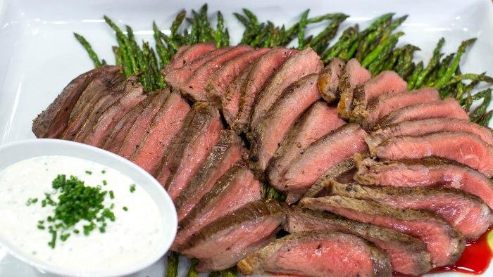 Sirloin tip steaks and asparagus with feta cream sauce