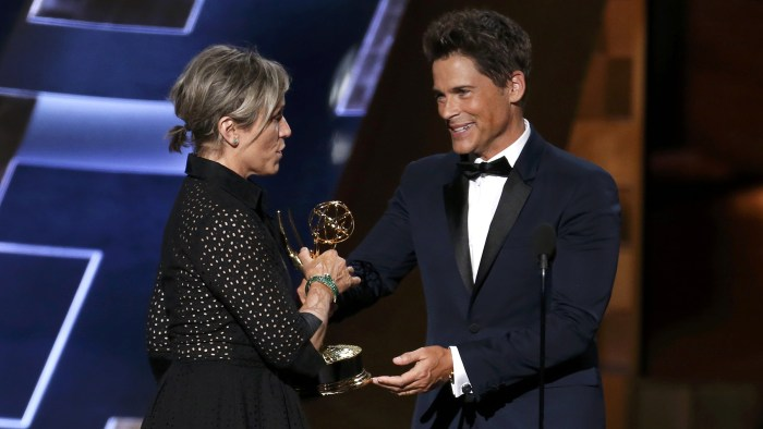"Image: McDormand accepts the award for Outstanding Lead Actress In A Limited Series Or A Movie for HBO's ""Olive Kitteridge"" from presenter Lowe at the 67th Primetime Emmy Awards in Los Angeles"