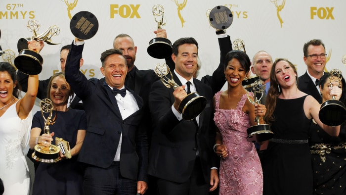 "Image: Producers and crew of ""The Voice"" pose with their awards during the 67th Primetime Emmy Awards in Los Angeles"