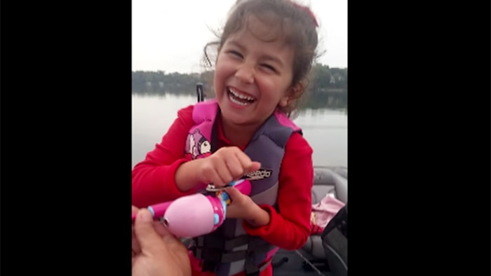 Little girl catches huge bass with a Barbie fishing pole