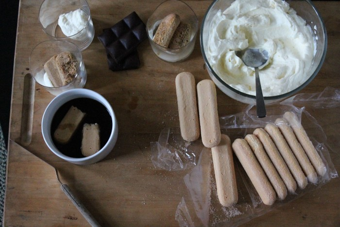 Tiramisu Parfaits step-by-step: Spoon the mascarpone mixture into a glass, then add an espresso-soaked ladyfinger