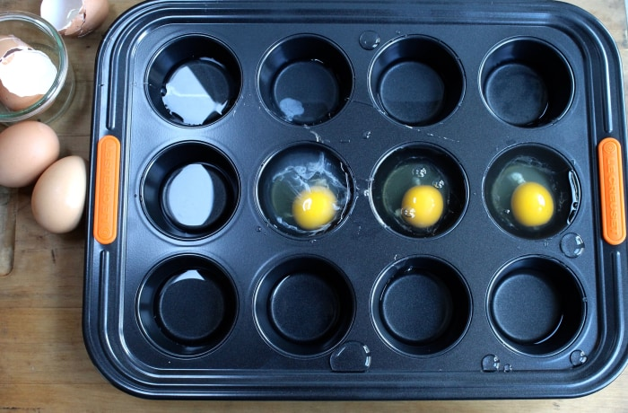 Crispy Rösti Potatoes with Oven-Poached Eggs: To poach the eggs, add oil, eggs and boiling water to each compartment of a muffin tin