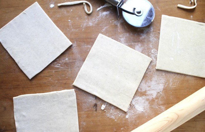 How to Make Sausage Puffs: Cut puff puff pastry into four 6-inch squares