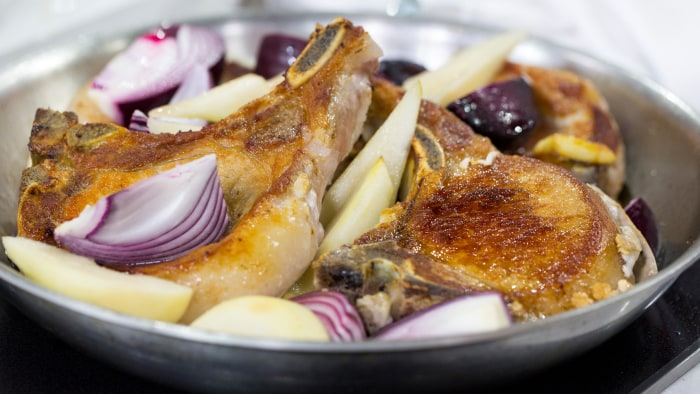 Lidia Bastianich's recipe for oven-braised pork chop with red onion and pear
