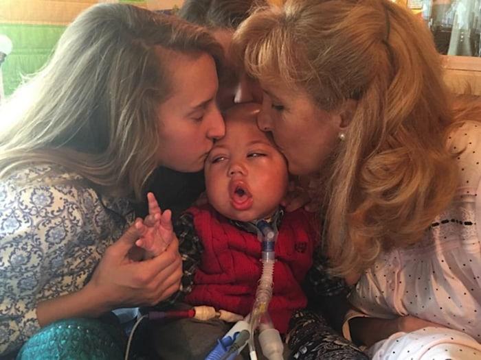 Salchert and daughter, Mary Elizabeth, 18, kiss Charlie.