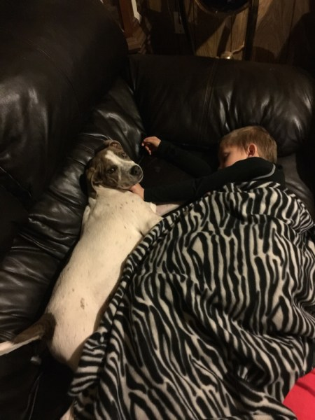 Kahne Williams sleeping with his dog Kase