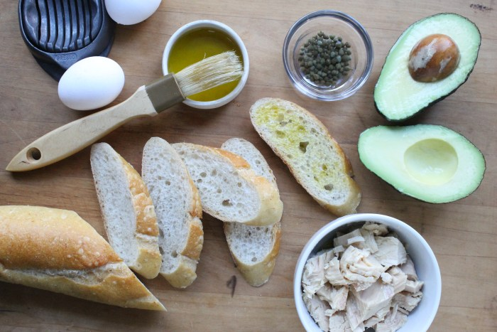 Avocado, Tuna and Egg Tartines: Brush the baguette slices with olive oil