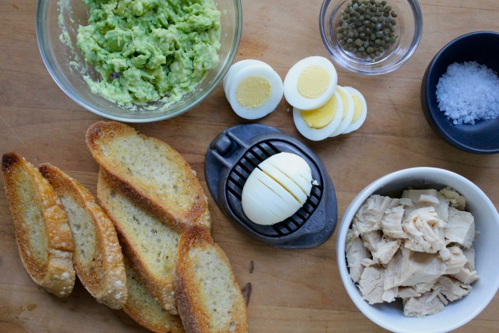 Avocado, Tuna and Egg Tartines: Slice the egg, mash the avocado with olive oil and toss the tuna with olive oil