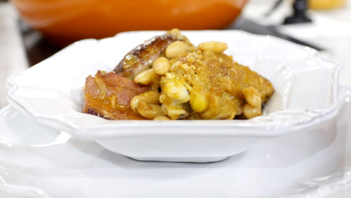 Chef Michael White cooks up a cassoulet, a French casserole, with bacon, beans and chicken