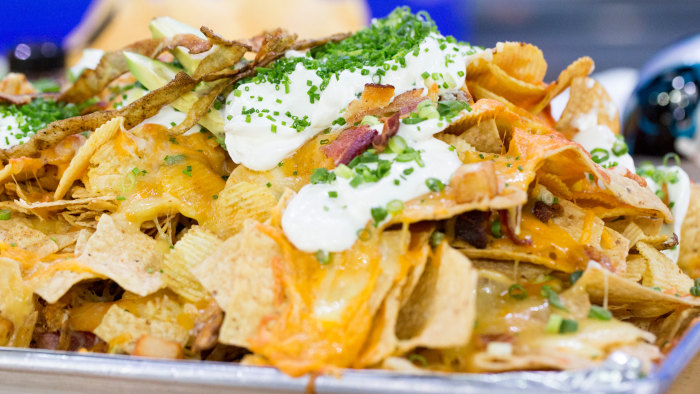 Adam Rappaport of Bon Apetit concocts five-part, 50-ingredient loaded Super Bowl nachos