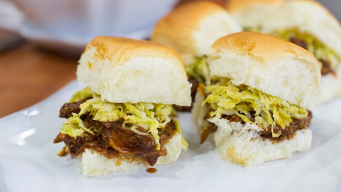Tiffani Thiessen's recipe for Super Bowl snacks, slow cooker pulled pork sliders with Brussels sprouts slaw and sweet potato tater tots