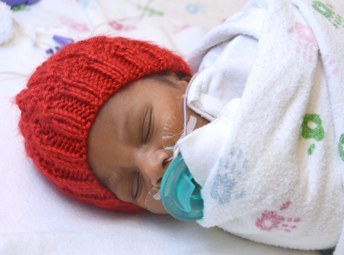 Volunteers needed! Knit or crochet a tiny red cap for a baby