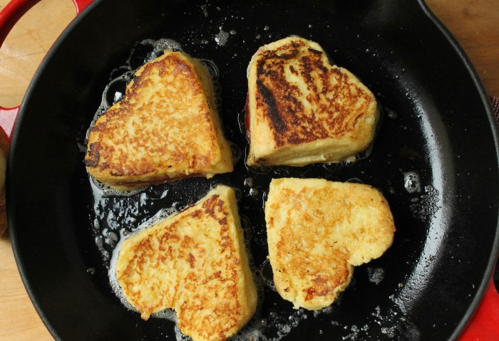Strawberry and Cream Stuffed French Toast: Cook in melted butter until browned
