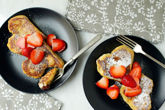 Strawberry and Cream Stuffed French Toast: Top with confectioners' sugar and macerated strawberries