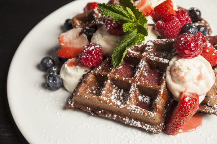 Chocolate Waffles with Cheesecake Mousse, Mixed Berries and Strawberry Sauce