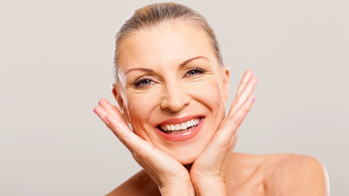 Image result for pictures of women putting on skin cream