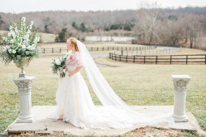Model with Down syndrome poses for wedding photo shoot