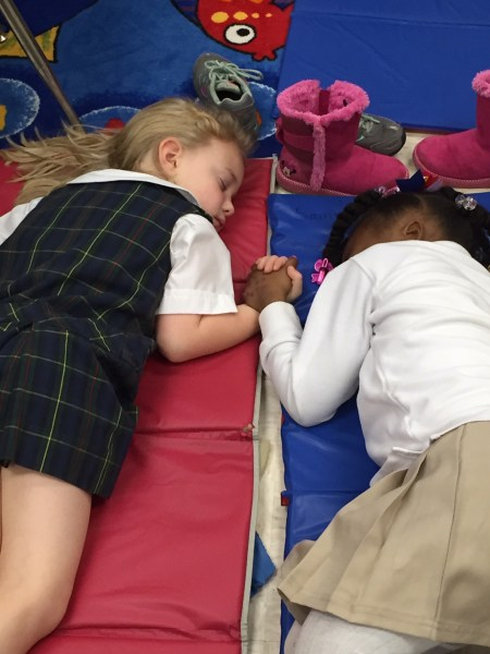 A photo of Lucy Harris Jackson and Samiyah Moore napping at school has gone viral