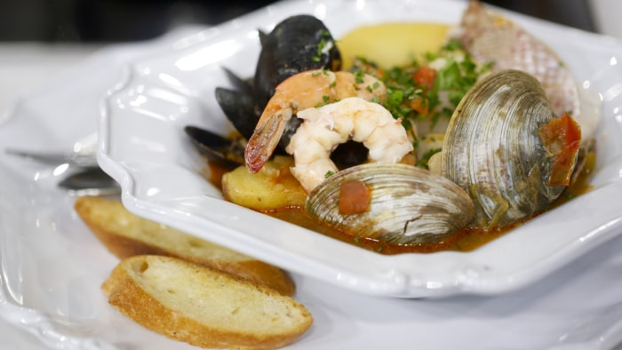 Bouillabaisse with garlic croutons for French fish stew