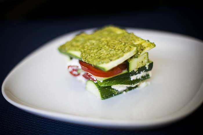 Make no-cook, gluten free, lasagna with tomato, basil pesto and zucchini