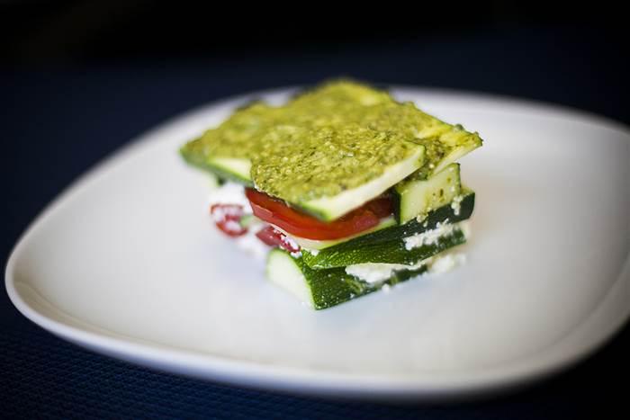 Make no-cook, gluten free, lasagna with tomato, basil pesto and zucchini