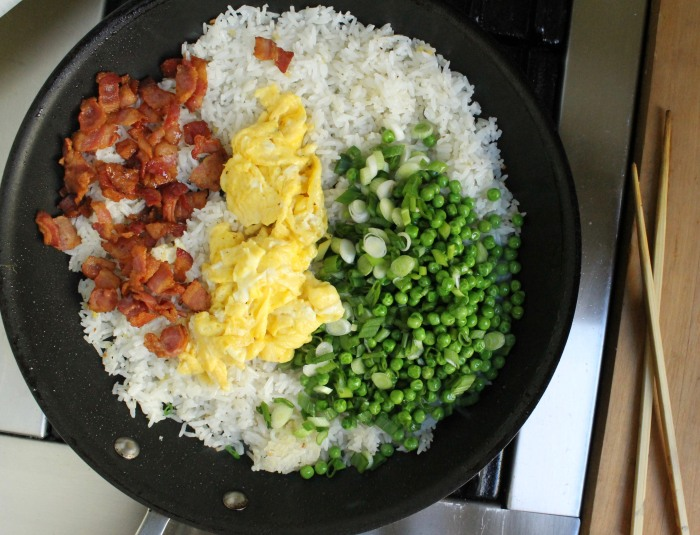 15-Minute Bacon and Egg Fried Rice: Add the bacon, scrambled eggs and peas