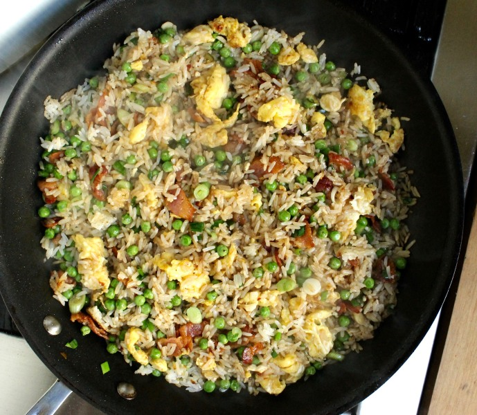 15-Minute Bacon and Egg Fried Rice: Stir until the rice is crispy and the liquid has been incorporated