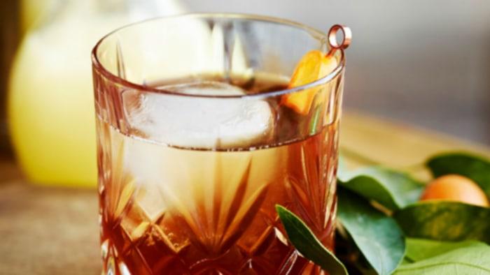 Cinco de mayo cocktail: Coffee margarita with kumquat garnish