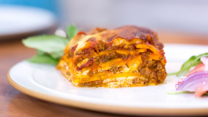 Kevin Curry cooks up low-calorie, gluten-free sweet potato lasagna with watermelon, feta and arugula salad