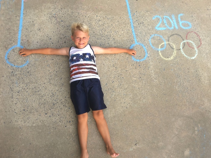 Create this Olympic action shot with sidewalk chalk and your future Olympian.