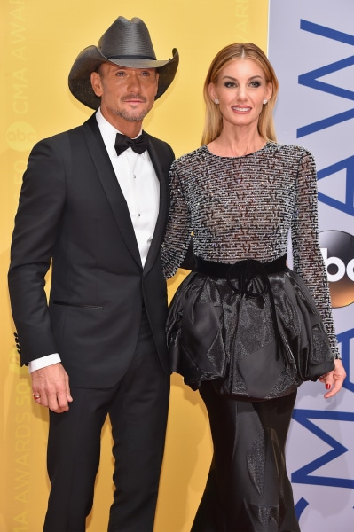Tim Mcgraw Greets Daughters 39 Dates Holding A Sledgehammer
