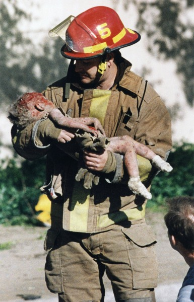 oklahoma city firefighter holding baby in iconic photo retires