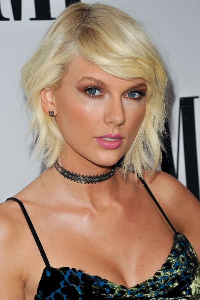taylor swift is back and her natural curls are causing a