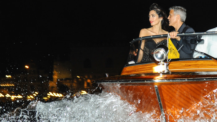 Splash News       George and Amal Clooney are seen on a taxi boat during the Venice Film Festival
