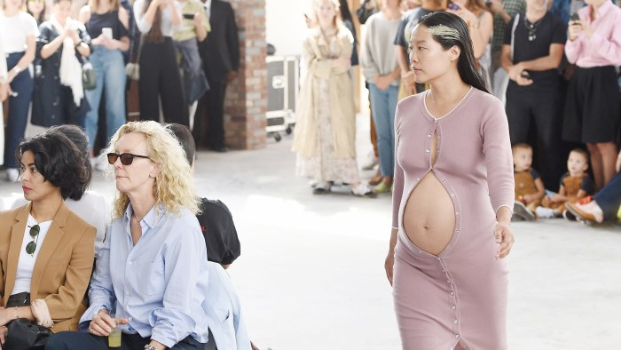 Baby's first runway! Pregnant model bares her bump at fashion week