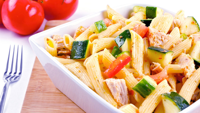 Bowl of pasta salad with vegetables and chicken