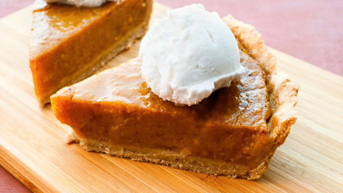 Homemade vegan pumpkin pie with coconut cream.