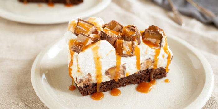 Cheesecake-Brownie Pie with Caramel Sauce