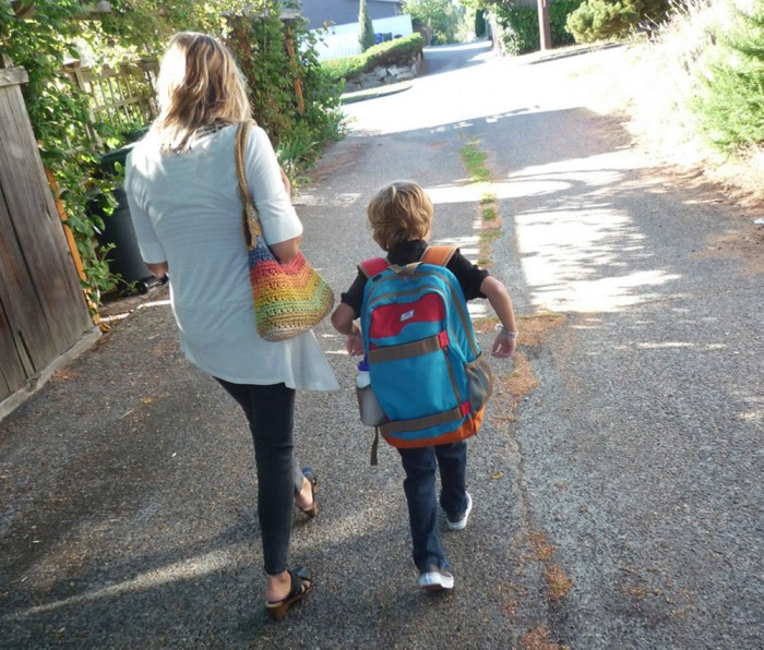 Writer Kurt Schlosser's wife and son walk to kindergarten