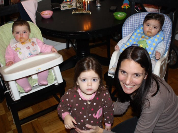 Wendy Bradford, with older daughter Molly and twins Henry and Ellie. Bradford worried when one of her twins started talking well before the other one.