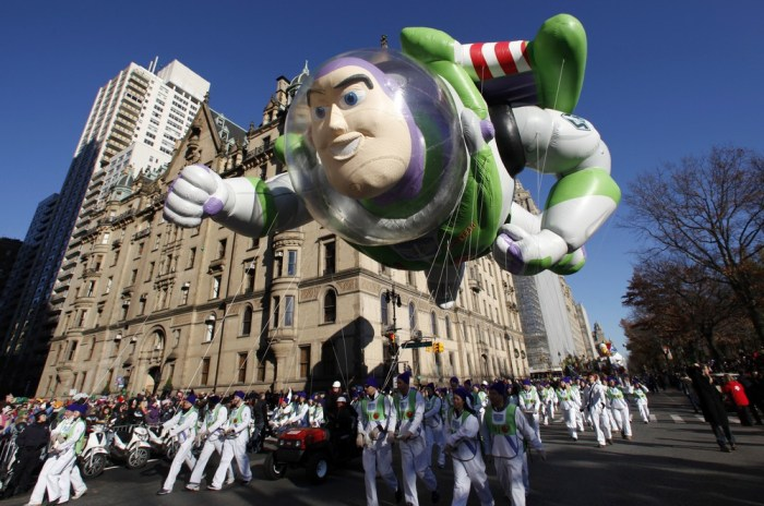 The Buzz Lightyear balloon floats down Central Park West during the 85th Macy's Thanksgiving day parade in New York City on November 24, 2011. Despite...