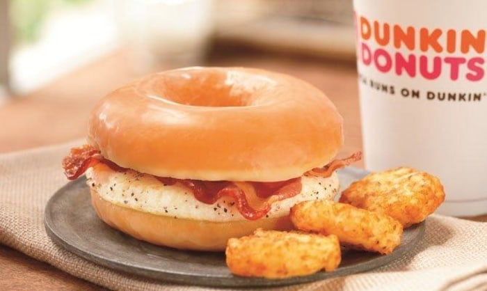 Dunkin' Donuts is trying out a glazed doughnut breakfast sandwich in certain eastern Massachusetts outlets.