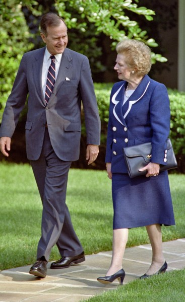 A picture dated June 20, 1991 shows US President George Bush (L) walking with former British Prime Minister Margaret Thatcher (R) as they leave the O...