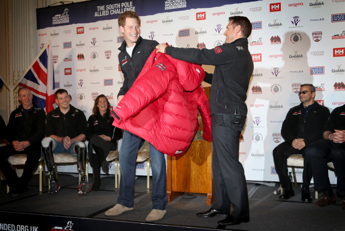 Image: Prince Harry is presented with a jacket by Inge Solheim