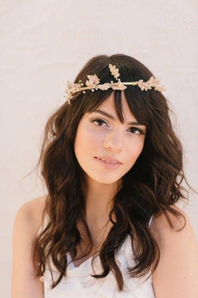 This headband is made from a gold brushed band, vintage velvet leaves in champagne, and hand-wired rhinestones.